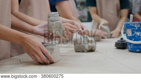 Kneading clay material before making pottery