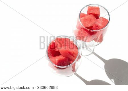 Close Up Diced Red Watermelon In Wineglass, Isolated On White. Copy Space
