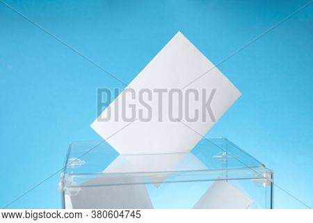 Voting Box With Bulletins On Blue Background, Space For Text
