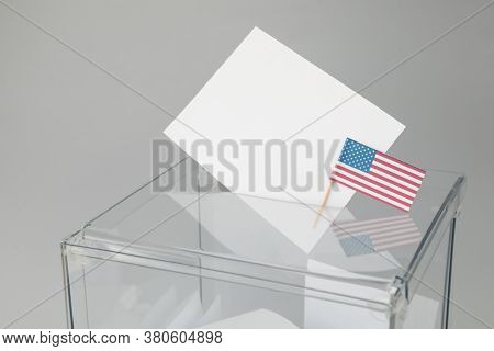 Voting Box With Bulletins And American Flag On Gray Background, Space For Text