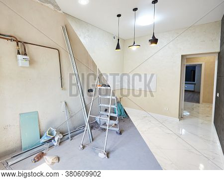 Comparative Building Project Of A Kitchen, Renovation Works Before And After, Messy Unfinished Room