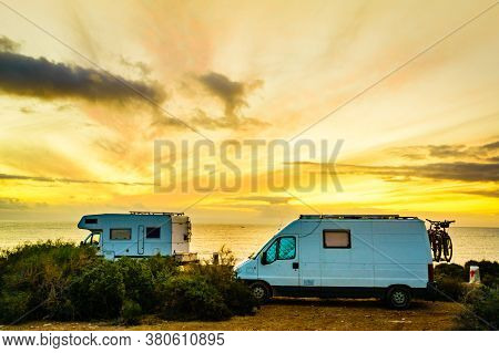 Campers Rv At Sunrise On Mediterranean Coast Costa Calida In Murcia Region, Spain. Camping On Nature