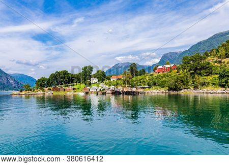 View On Ornes, Famous For Urnes Stave Church, From The Liitle Ferry Crossing Lustrafjorden Between S