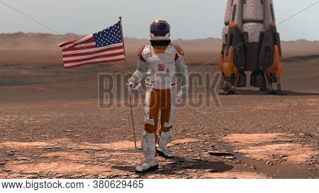 Astronaut Walking On Mars With American Flag. Exploring Mission To Mars Red Planet. Futuristic Colon