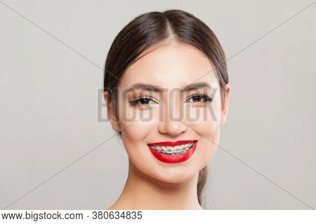 Cheerful Woman With Braces On Teeth. Beautiful Model In Braces Smiling On White Background