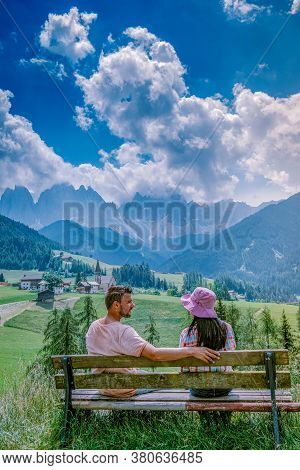 Couple On Vacation In The Dolomites Italy, Santa Magdalena Village In Dolomites Area Italy Val Di Fu