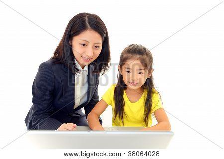 Little girl using a laptop