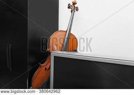 A Cello Hidden Behind A Tv Set, Indoor Shot