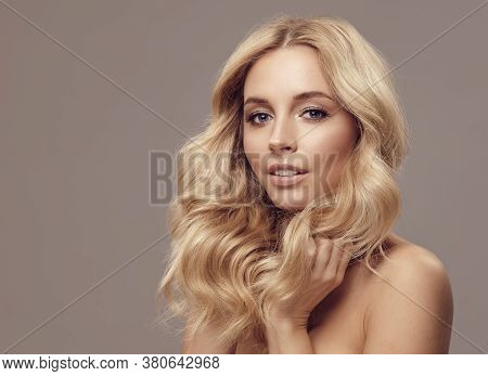 Portrait Of Beauty Caucasian Blond Woman Face Clean Skin Beautiful Female Eyes Lips With Perfect Hea