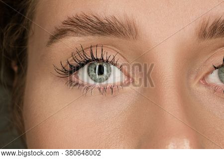 Calm. Close Up Of Face Of Beautiful Caucasian Young Woman, Focus On Eyes. Human Emotions, Facial Exp