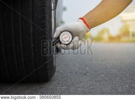In Mobile, A Pressure Measuring Device For Measuring Tire Pressure.