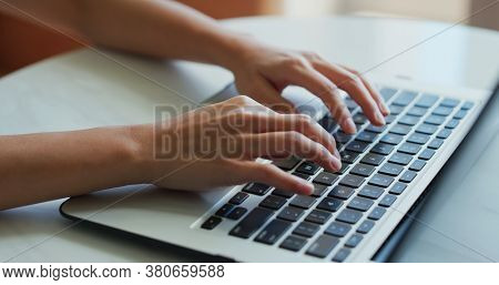 Woman type on laptop computer