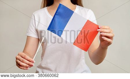 France Flag. European Culture. Woman Holding Official National Symbol Tricolor With Three Vertical B