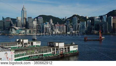 Victoria Harbor, Hong Kong 01 July 2020 : Hong Kong city with pier dock