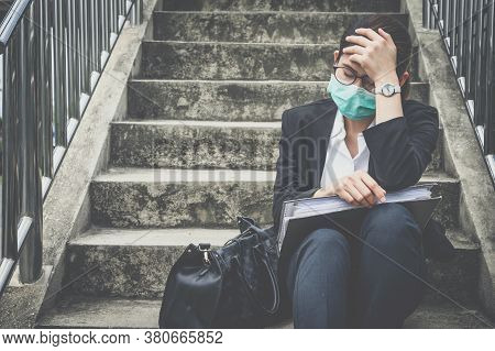 Portrait Of Unemployed Businesswoman Stressed After Failure And Laid Off From Work Because Impact Fr