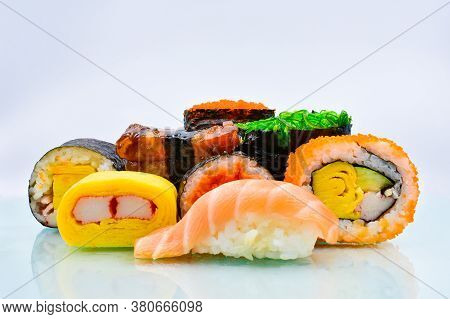 Sushi Japanese Food, Tuna Salmon Rolls, Fever Rolls And Avocado Various Perspectives On Sushi Rainbo