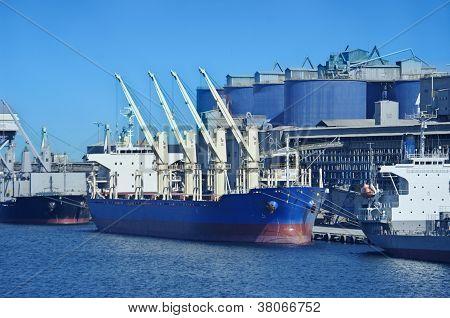 Vessel under loading in Donghae port Korea. poster
