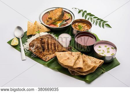 Indian Fish Platter Or Seafood Thali Served In A Steel Plate Or Over Banana Leaf