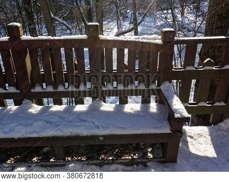 Wooden Bench In Winter In The Forest, Moscow
