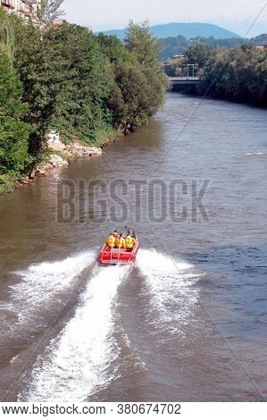 Red Fire Brigade Rescue Boat With People In Life Vests On A River
