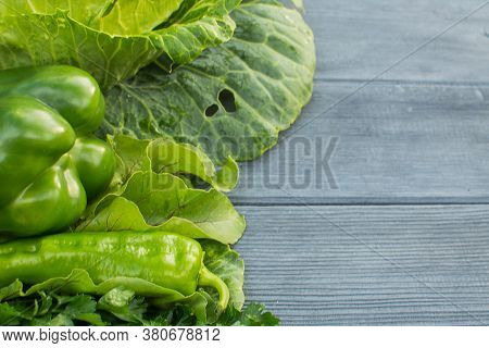 Fresh Green Vegetables On An Old Wooden Rustic Table. Concept - Healthy Food, Alkaline Diet. Flatlay