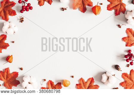 Autumn Composition. Frame Made Of Flowers, Maple Leaves On Gray Background. Autumn, Fall, Thanksgivi