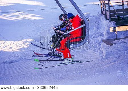 Lalpe Dhuez, France 30.12.2019 A Group Of Children With Ski Teacher Climbs The Ski Lift. Cableway Li