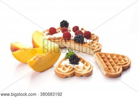 Waffles With Berries And Peaches Isolated On White Background