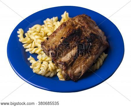 Grilled Pork Ribs With Pasta. Grilled Pork Ribs On Blue Plate Isolated On White Background. Grilled