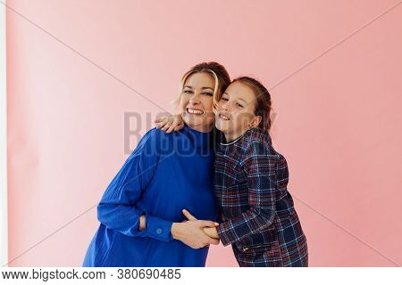 Mom And Daughter Cuddle Love Family Pink Background