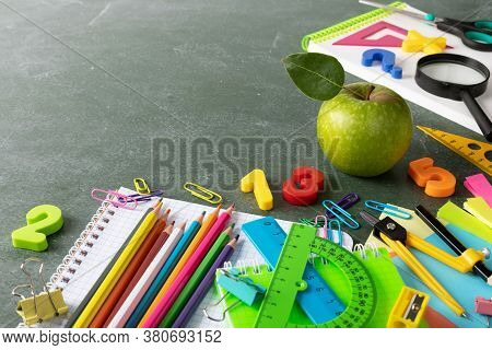 Back To School And Education Background With Colorful Stationery Supplies And Fresh Green Apple On E
