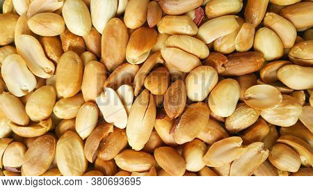 Background Of Fried Peeled Pistachios. Pistachio Nuts Without Skin. Flatly Photo.