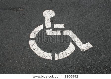 White Handicapped Symbol On Pavement