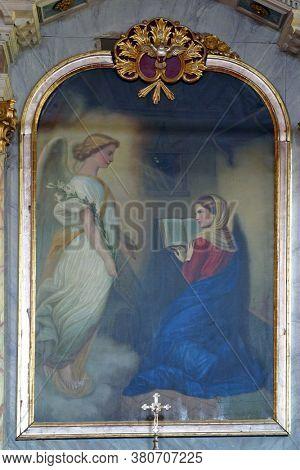 KLANJEC, CROATIA - SEPTEMBER 17, 2012: Annunciation, altar painting on main altar in Franciscan church Annunciation of Virgin Mary in Klanjec, Croatia