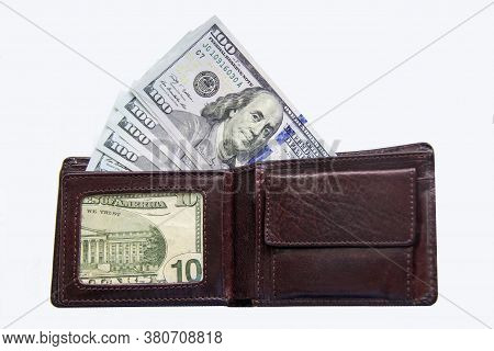 Wallet Lies On A White Background With Money. Money Dollars Lies In A Wallet On A White Background.
