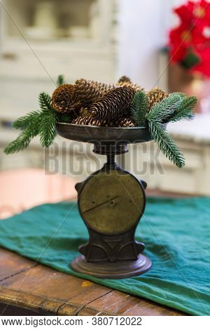 Stylish Antique Decor With Pine Cones. A Handful Of Pine Cones On An Antique Bronze Scale