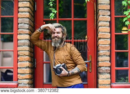 Brutal Man With Retro Camera. Creative Career. Professional Photographer Use Vintage Camera. Photo S