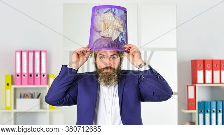 Business And Trash As Hat. Man Search Crimpled Paper In Basket. Ceo In Messy Office. Throw Garbage I