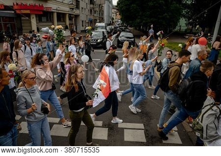 Minsk, Belarus - August 13, 2020: Belarusian People In White Clothes With Flowers Participate In Pea