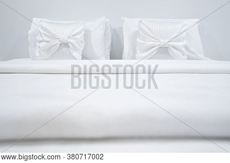 Two White Pillows Placed At The Head Of The Bed. Comfortable And Soft Pillows On Bed In Modern Bedro