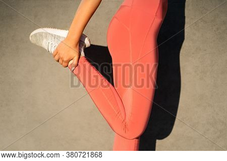 Close Up Of Woman In Pink Leggings Stretching Muscles Making Functional Training, Doing Exercises Fo