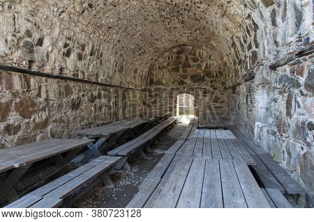 Bohusl N, Sweden - June 17 2019: The View Of Bohus Fortress Inside With Wooden Benches And Tables On