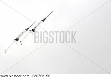 Medical Syringe. Clouse Up Of Syringe On White Background.