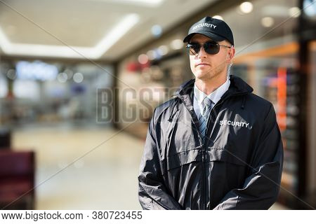 Security Guard Officer Standing In Shopping Mall