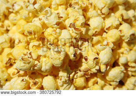 Pop Corn. Popcorn background. Full Frame of Fresh Hot Buttered Popcorn.