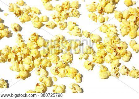 Pop Corn. Popcorn isolated on white. Background of buttered pop corn on a white background.