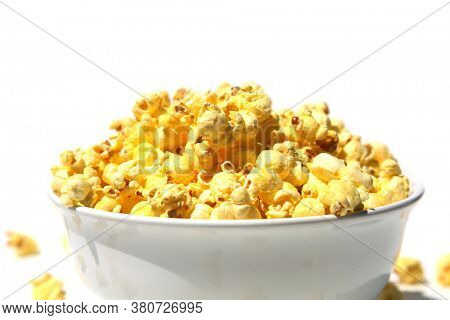 Pop Corn. Popcorn in a white bowl isolated on white. Bowl of buttered pop corn on a white background.