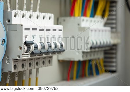 Close-up Of Voltage Switchboard With Circuit Breakers. Electrical Background