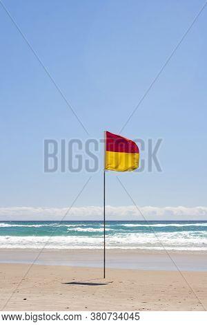 Lifesaving Flag. Swimming Flag On Australian Beach