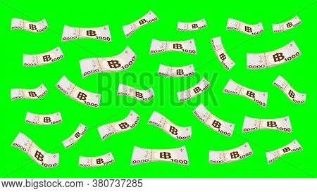1000 Baht Thai Money Flying Isolated On Green Screen Background, Banknote Money Falling Over Green